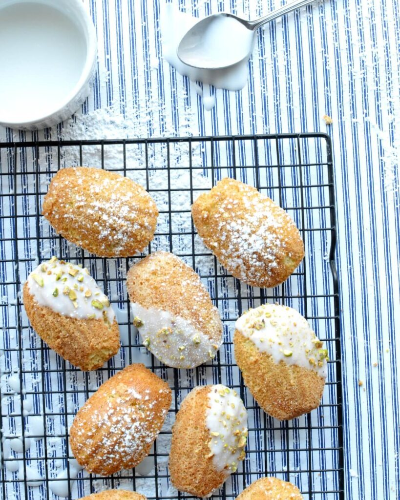 Gluten free madeleines on a cooling rack