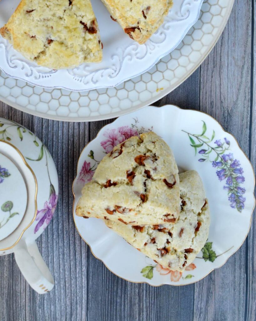 a plate of two cinnamon chip scones