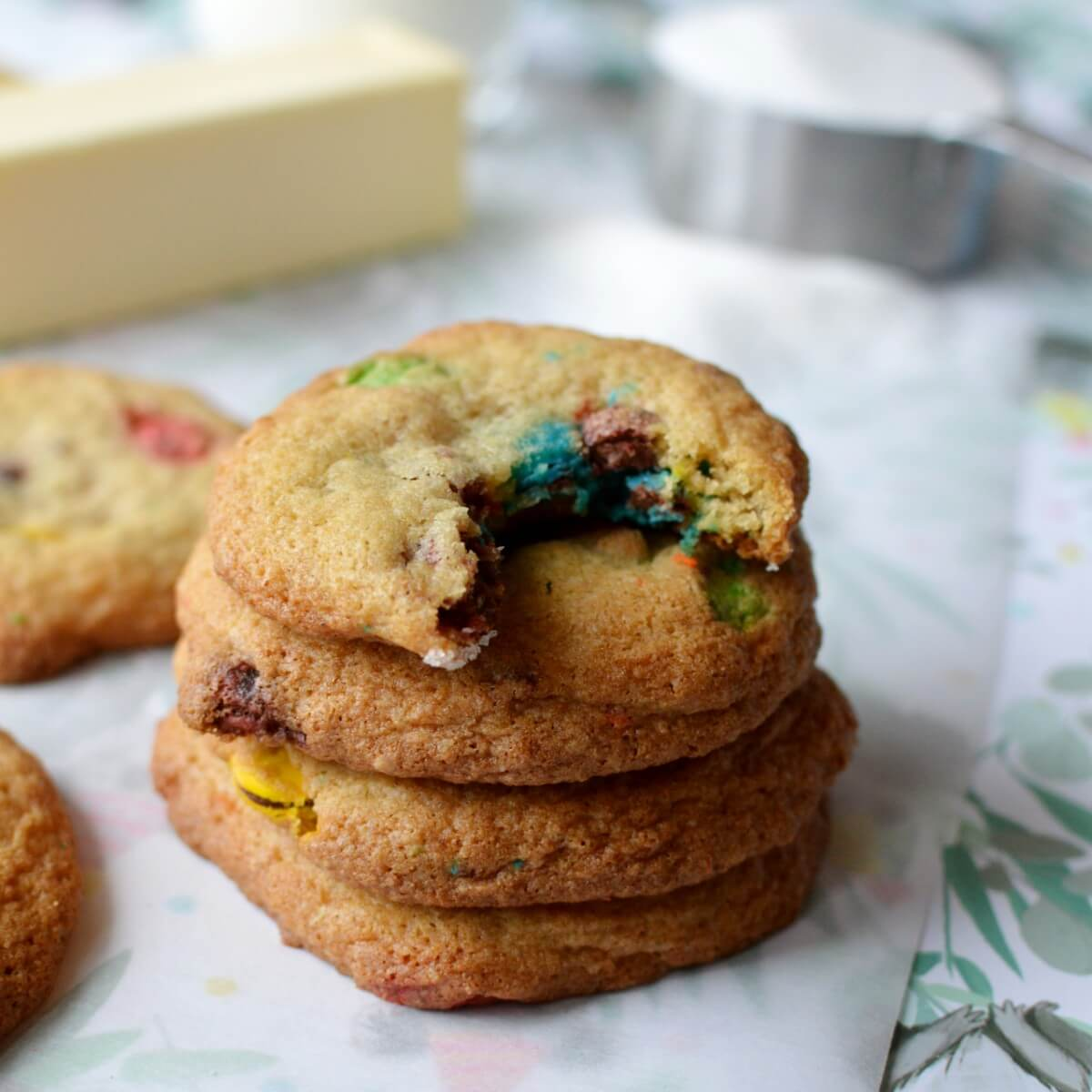 A stack of gluten free cookies with a bite out of the top cookie.