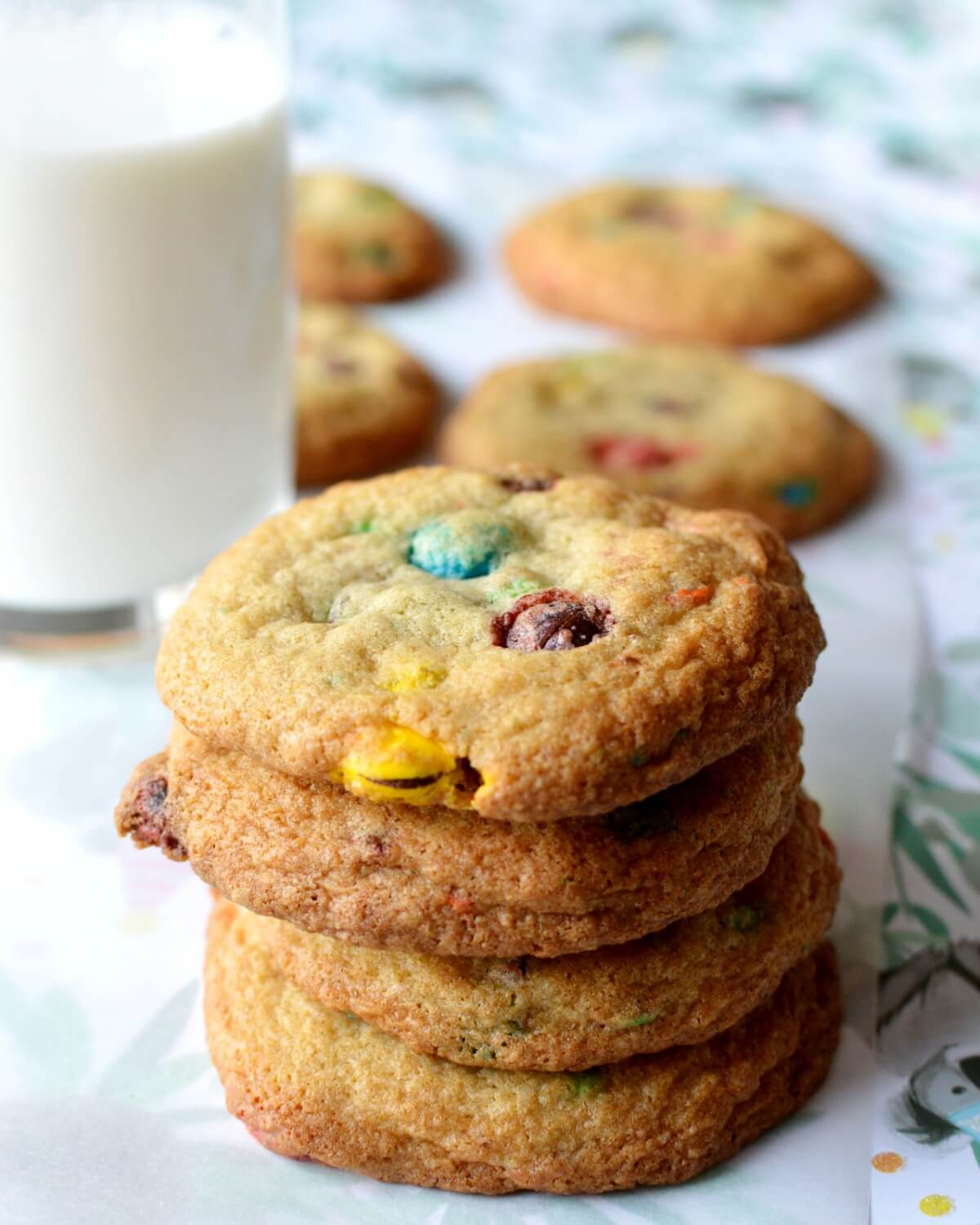 A close up of a stack of m&m cookies.