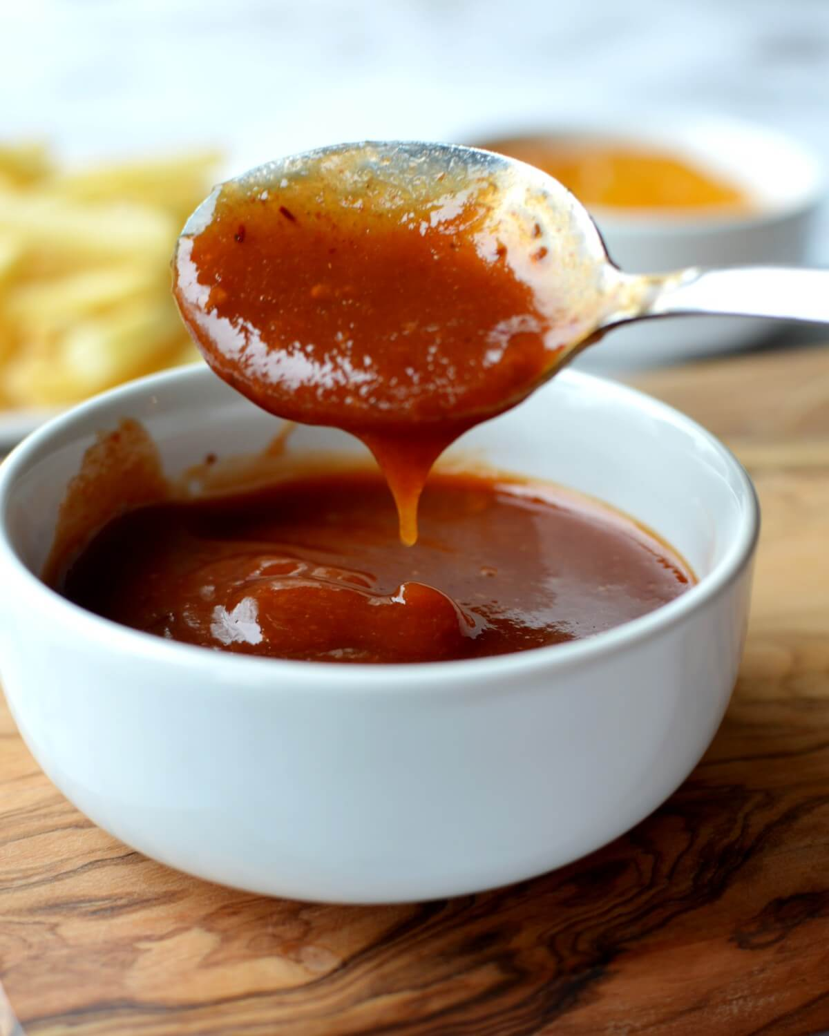 A spoonful of peach bbq sauce