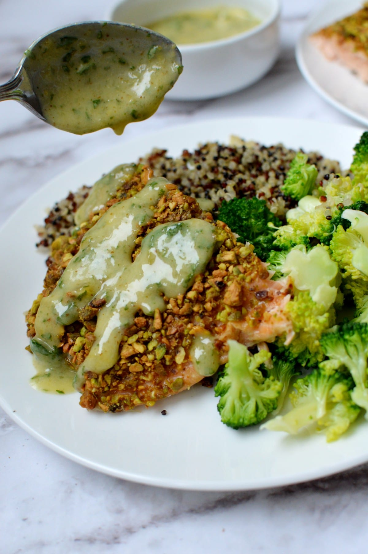 A plate of salmon with broccoli and quinoa