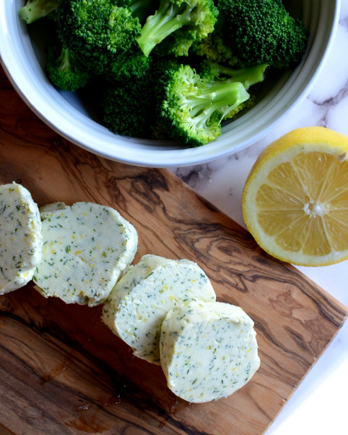 Sliced lemon dill butter with broccoli