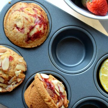 A muffin pan with strawberry muffins
