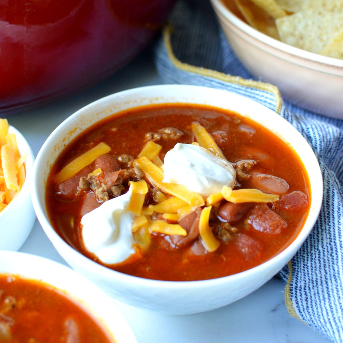 a bowl of chili with cheese
