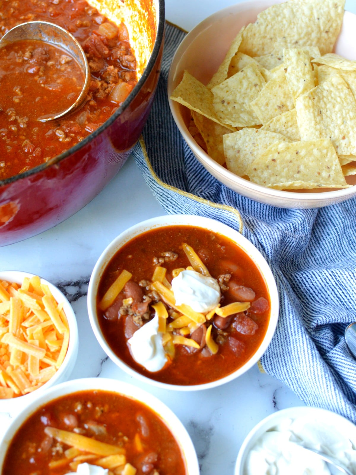 bowls of classic chili with cheese