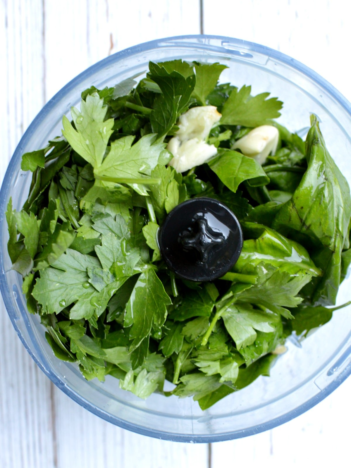 parsley and basil in a food processor