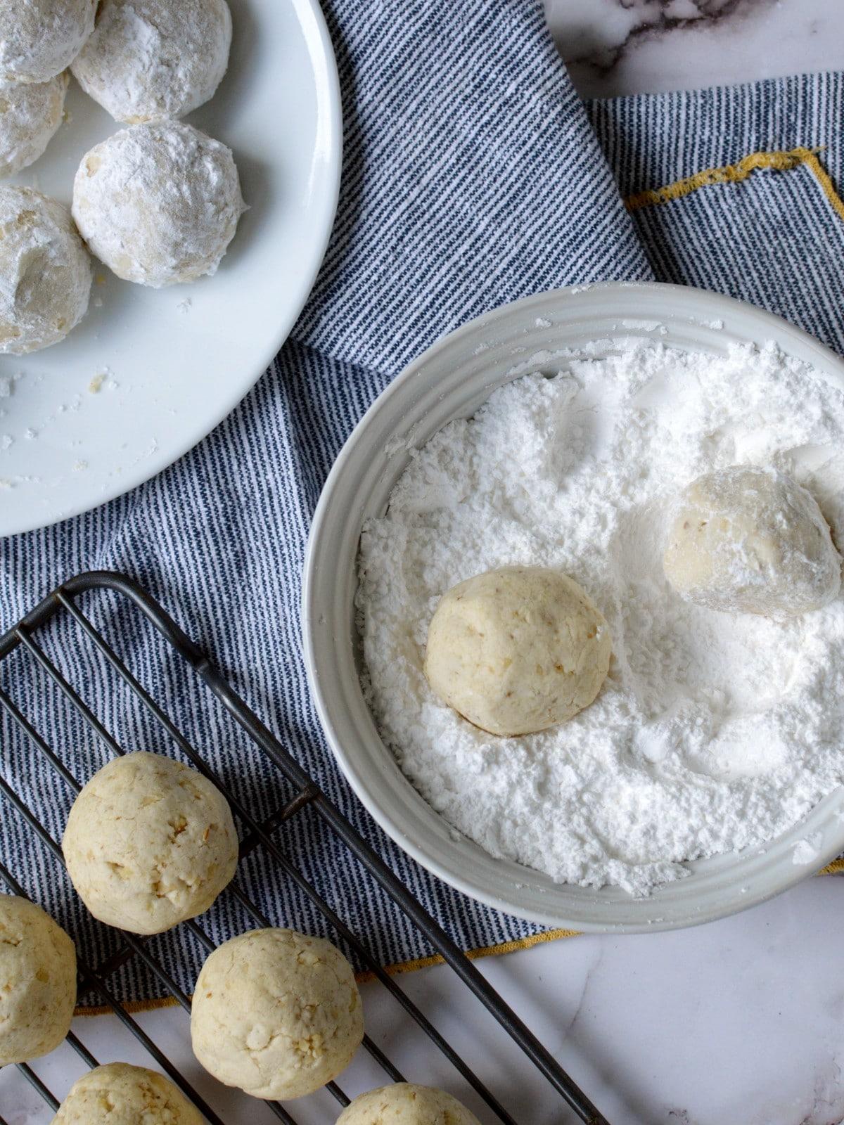 rolling cookies in powdered sugar